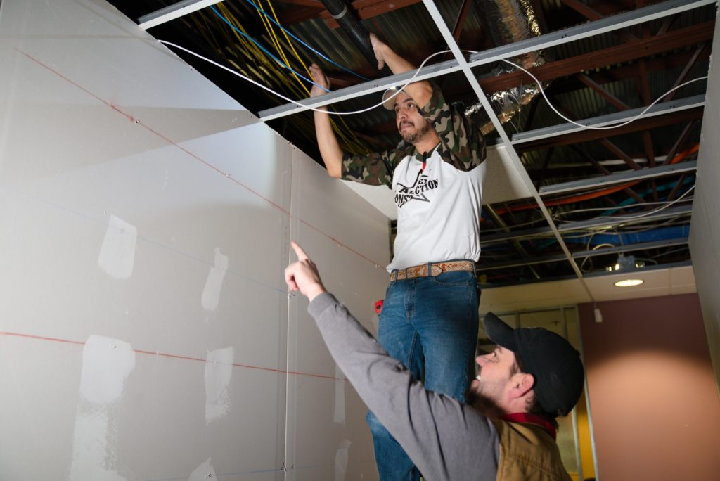 Man working on electric wiring in ceiling